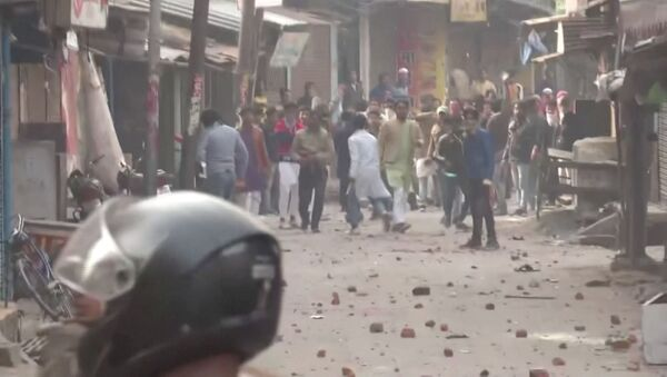 Protesters pelt stones at police personnel during clashes over citizenship law in Gorakhpur, Uttar Pradesh, India December 20, 2019 in this still image taken from a video - Sputnik International