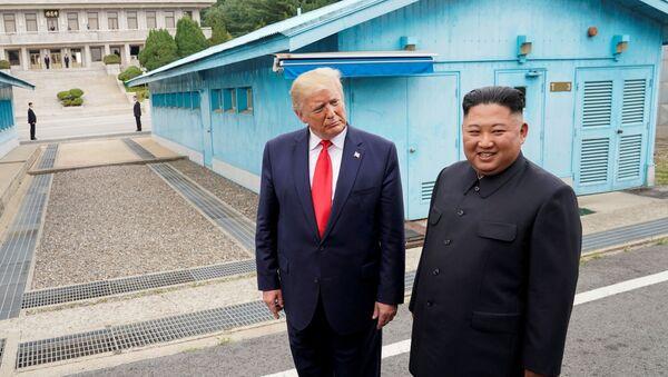 U.S. President Donald Trump meets with North Korean leader Kim Jong Un at the demilitarized zone separating the two Koreas, in Panmunjom, South Korea, June 30, 2019 - Sputnik International