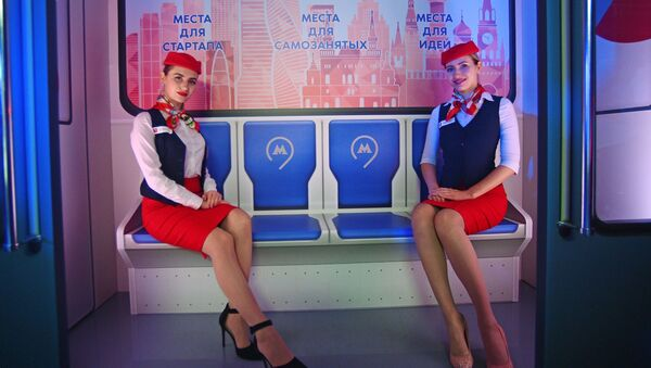 Models dressed as Moscow metro employees pose for pictures in a themed Moscow Businessman train - Sputnik International
