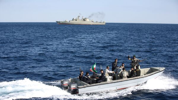 Iranian marine soldiers wave to the camera from a motor boat in the Sea of Oman during the third day of joint Iran, Russia and China naval war games - Sputnik International