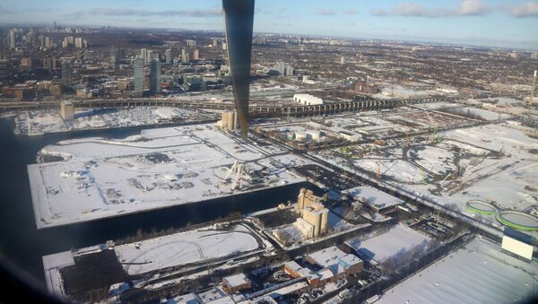 Snow covers the building site of tech company Sidewalk Labs' smart-city as seen from a landing commuter plane in Toronto, Ontario, Canada December 6, 2019. - Sputnik International