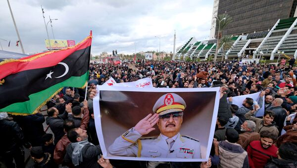 Libyan protesters gather during a demonstration against the Turkish parliament's decision to send Turkish forces to Libya, in Benghazi, Libya January 3, 2020.  - Sputnik International