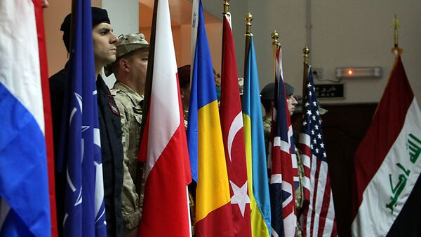 NATO soldiers stand to attention during a ceremony in the Iraqi capital Baghdad - Sputnik International