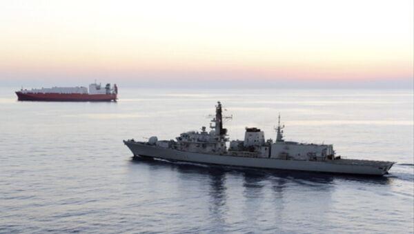 British navy vessel HMS Montrose escorts another ship - Sputnik International