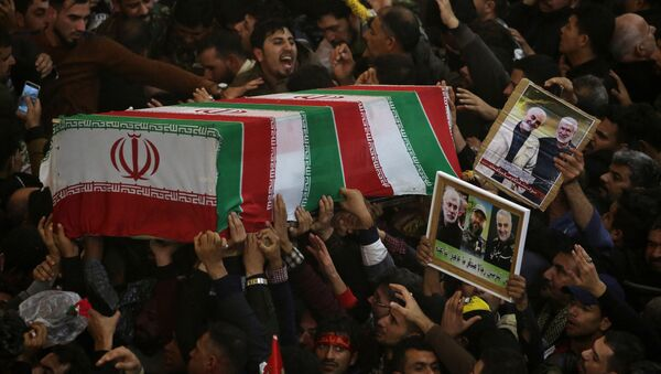 Mourners attend the funeral procession of the Iranian Major-General Qassem Soleimani, head of the elite Quds Force of the Revolutionary Guards, and the Iraqi militia commander Abu Mahdi al-Muhandis, who were killed in an air strike at Baghdad airport, in Kerbala, Iraq, January 4, 2020.  - Sputnik International
