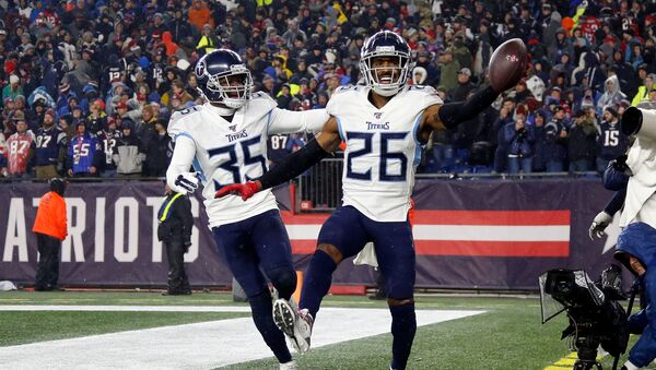 Tennessee Titans cornerback Logan Ryan (26) celebrates with defensive back Tramaine Brock (35) after scoring a touchdown on an interception against the New England Patriots during the second half at Gillette Stadium.  - Sputnik International