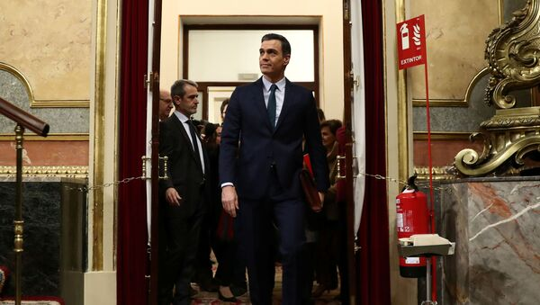 Spain's acting Prime Minister Pedro Sanchez arrives to attend the investiture debate at the Spanish Parliament in Madrid, Spain, 5 January 2020. REUTERS/Sergio Perez - Sputnik International