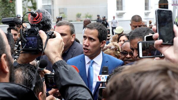 Venezuelan opposition leader Juan Guaido, who many nations have recognised as the country's rightful interim ruler, speaks to reporters outside Venezuela's National Assembly building in Caracas in Caracas, Venezuela January 5, 2020. - Sputnik International