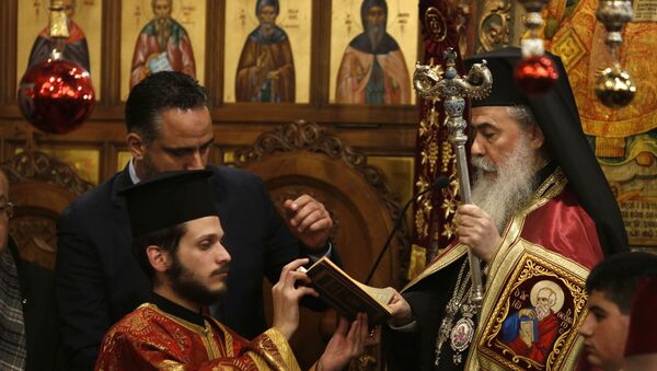 Greek Orthodox Patriarch of Jerusalem Theophilos III holds mass in the Church of the Nativity, built atop the site where Christians believe Jesus Christ was born, to celebrate Christmas according to the Eastern Orthodox calendar, in the West Bank City of Bethlehem - Sputnik International