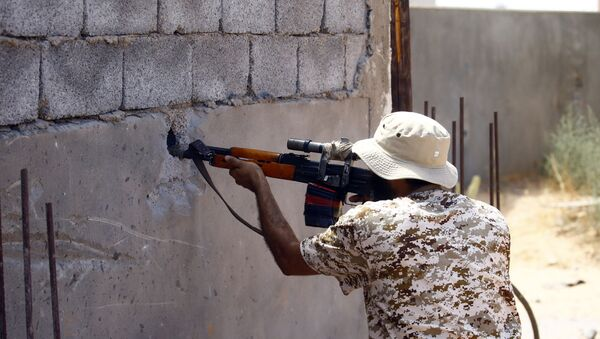 A fighter loyal to the internationally recognised Libyan Government of National Accord (GNA) in the capital Tripoli's suburb of Ain Zara - Sputnik International