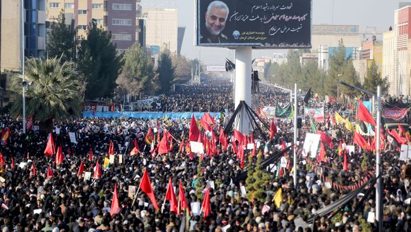 Iranian people attend a funeral procession and burial for Iranian Major-General Qassem Soleimani, head of the elite Quds Force, who was killed in an airstrike at Baghdad airport, at his hometown in Kerman, Iran January 7, 2020 - Sputnik International