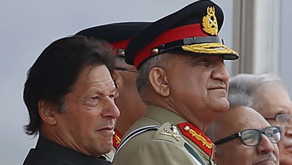 In this March 23, 2019 photo, Pakistan's Army Chief Gen. Qamar Javed Bajwa, center, watches a parade with Prime Minister Imran Khan, left, and President Arif Alvi, in Islamabad, Pakistan.  - Sputnik International