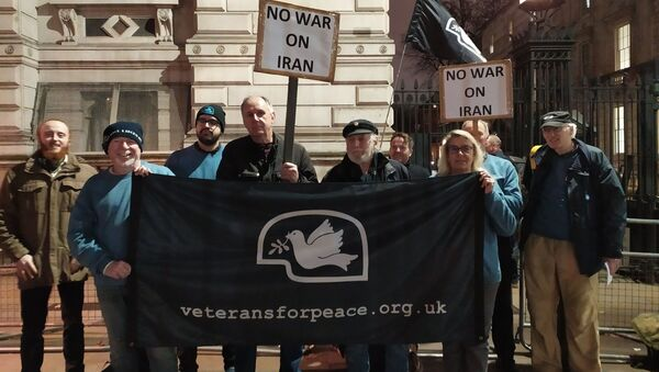Veterans for Peace UK members stand infront of 10 Downing Street on 7 July 2020 in opposition to war with Iran - Sputnik International