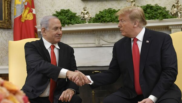 President Donald Trump, right, and Israeli Prime Minister Benjamin Netanyahu, left, shake hands in the Oval Office of the White House in Washington, Monday, March 25, 2019, at the beginning of their meeting.  - Sputnik International