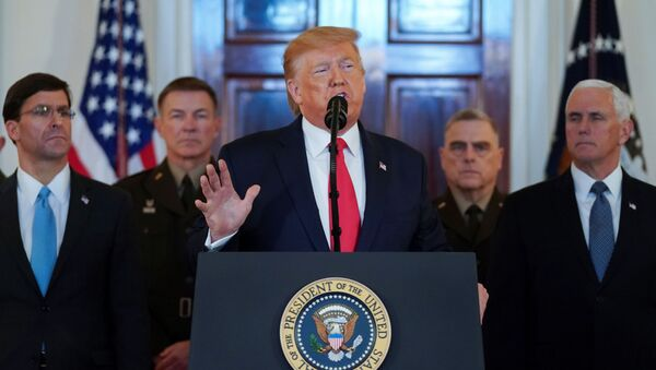 U.S. President Donald Trump delivers a statement about Iran flanked by U.S. Secretary of Defense Mark Esper, Vice President Mike Pence and military leaders in the Grand Foyer at the White House in Washington, U.S., January 8, 2020. - Sputnik International