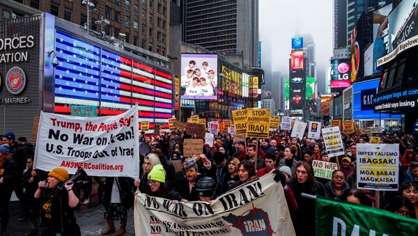 People march as they take part in an anti-war protest amid increased tensions between the United States and Iran at Times Square in New York, U.S., January 4, 2020 - Sputnik International