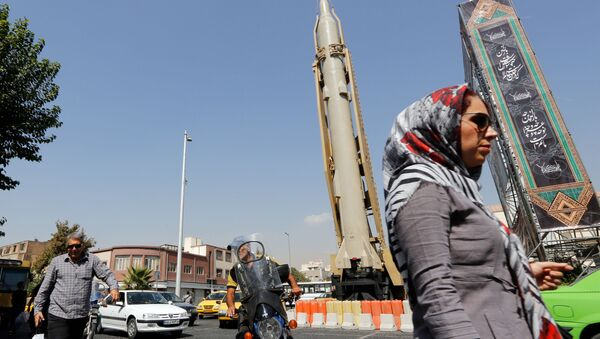 A Shahab-3 surface-to-surface missile is pictured on display in a street exhibition by Iran's army and paramilitary Revolutionary Guard celebrating  Defence Week marking the 39th anniversary of the start of 1980-88 Iran-Iraq war, at the Baharestan Square in Tehran, on September 26 2019 - Sputnik International