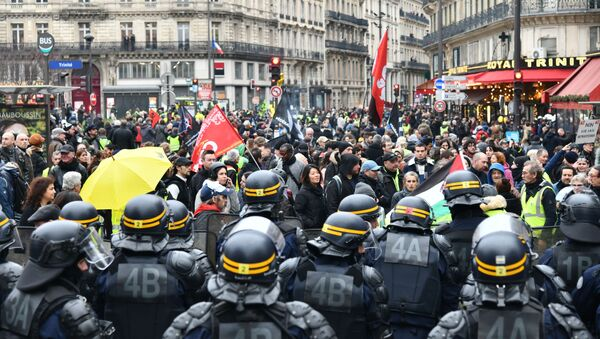 Protesters face off with CRS riot police during a demonstration as part of the 36th consecutive day of strike against French government's pensions reform plans, in Paris, France. - Sputnik International