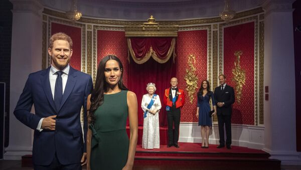 The figures of Britain's Prince Harry and Meghan, Duchess of Sussex, left, are moved from their original positions next to Queen Elizabeth II, Prince Philip and Prince William and Kate, Duchess of Cambridge, at Madame Tussauds in London, Thursday Jan. 9, 2020. Madame Tussauds moved its figures of Prince Harry and Meghan, Duchess of Sussex from its Royal Family set to elsewhere in the attraction.  - Sputnik International