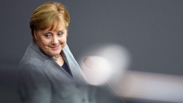 German Chancellor Angela Merkel attends a session of lower house of parliament, the Bundestag, in Berlin, Germany, December 18, 2019 - Sputnik International