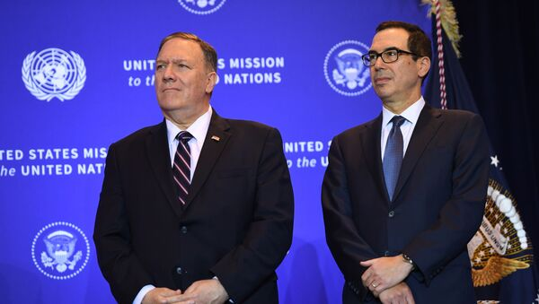 US Secretary of State Mike Pompeo and Secretary of the Treasury Steven Mnuchin listen as President Donald Trump speaks at a press conference in New York, September 25, 2019, on the sidelines of the United Nations General Assembly. - Sputnik International