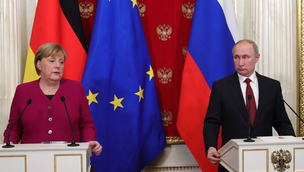 German Chancellor Angela Merkel and Russian President Vladimir Putin speak at a press conference at the Kremlin on Saturday, 11 January 2020 - Sputnik International