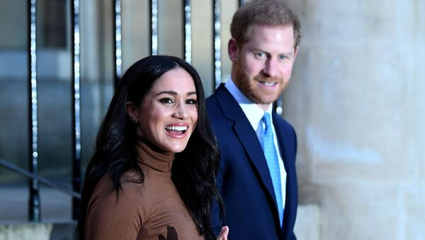 Britain's Prince Harry and his wife Meghan, Duchess of Sussex react as they leave after their visit to Canada House in London, Britain  January 7, 2020 - Sputnik International