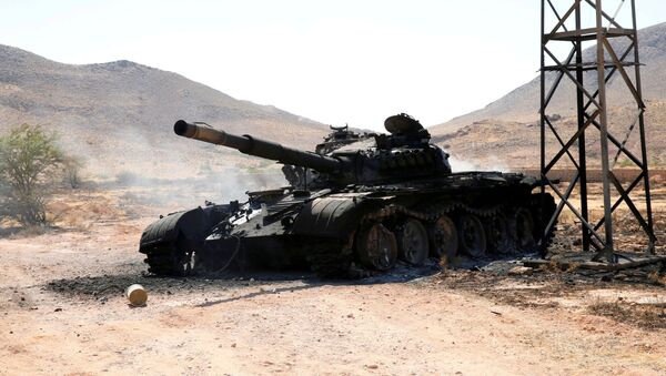 A destroyed and burnt tank that belonged to the eastern forces led by Khalifa Haftar, is seen in Gharyan south of Tripoli - Sputnik International