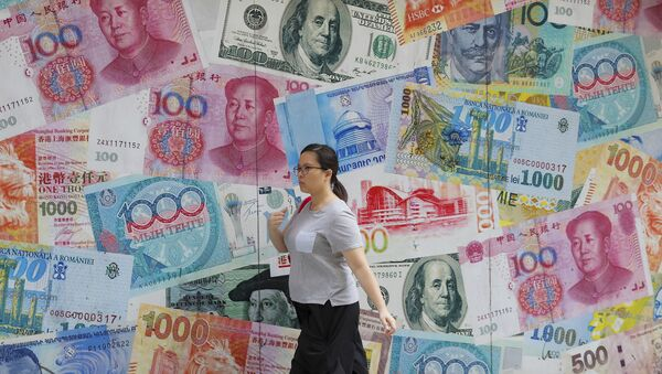 A woman walks by a money exchange shop decorated with different countries currency banknotes at Central, a business district in Hong Kong, Tuesday, Aug. 6, 2019 - Sputnik International