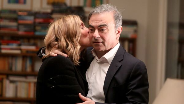 Former Nissan chairman Carlos Ghosn and his wife Carole Ghosn pose for a picture after an exclusive interview with Reuters in Beirut, Lebanon January 14, 2020 - Sputnik International
