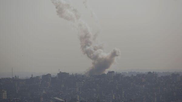 Smoke rises after an Israeli forces strike in Gaza City - Sputnik International