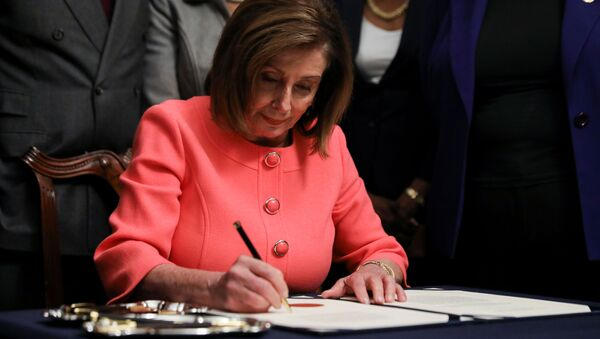U.S. House Speaker Nancy Pelosi (D-CA) signs the two articles of impeachment of U.S. President Donald Trump before sending them over to the U.S. Senate during an engrossment ceremony at the U.S. Capitol in Washington, U.S., January 15, 2020 - Sputnik International