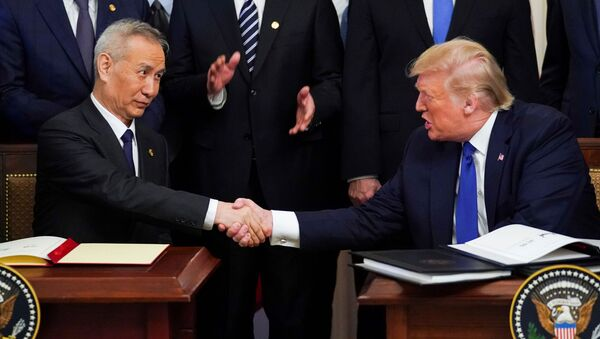 Chinese Vice Premier Liu He and U.S. President Donald Trump shake hands after signing phase one of the U.S.-China trade agreement - Sputnik International