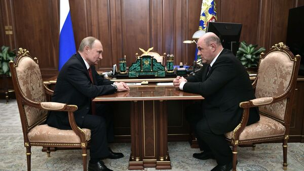 Russian President Vladimir Putin and Head of the Federal Tax Service Mikhail Mishustin, nominated on the post of the prime minister - Sputnik International