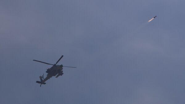 Israeli attack helicopter fires a missile into Gaza - Sputnik International