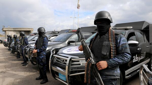 Central security support force carry weapons during the security deployment in the Tajura neighborhood, east of Tripoli, Libya January 14, 2020 - Sputnik International