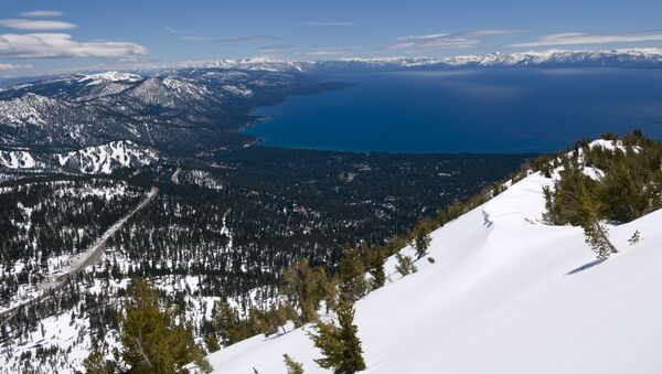 This photo shows a view of Lake Tahoe near Reno, Nev., after several recent storms added to the snow pack, Thursday, May 26, 2011. Squaw Valley ski resort, in Olympic Valley, Calif., will now be open for skiing Memorial Day weekend due to the snow. (AP Photo/Scott Sady) - Sputnik International