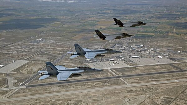 F-35C Lightning IIs, attached to the Grim Reapers of Strike Fighter Squadron (VFA) 101, and an F/A-18E/F Super Hornets attached to the Naval Aviation Warfighter Development Center (NAWDC) fly over Naval Air Station Fallon (NASF).  - Sputnik International