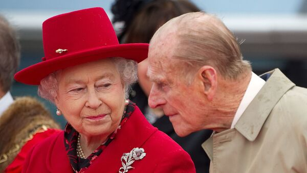 Britain's Queen Elizabeth speaks to her husband Prince Philip as they attend the official re-opening of the Cutty Sark in Greenwich, London  April 25, 2012. - Sputnik International