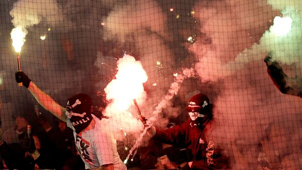 Supporters of St. Pauli light fireworks during the German soccer cup second round match between FC St. Pauli and Borussia Dortmund - Sputnik International