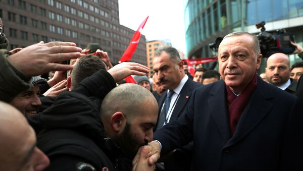 Turkish President Tayyip Erdogan is greeted by his supporters as he arrives for the Libya summit in Berlin, Germany, January 19, 2020.  - Sputnik International