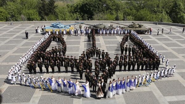 Young military cadets and schoolgirls stand in shape of a trident, a Ukrainian national symbol, as they attend a parade of Kiev military schools, within the program of military and patriotic education, timed to celebrate Victory Day at the WWII memorial in Kiev, Ukraine, Friday, May 4, 2018. Ukraine marks Victory Day on May 9. - Sputnik International