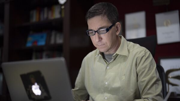In this July 10, 2019 file photo, U.S. journalist Glenn Greenwald checks his news website at his home in Rio de Janeiro, Brazil. Brazilian prosecutors accused Greenwald on Tuesday, Jan. 21, 2020, of involvement in hacking the phones of Brazilian officials involved in a corruption investigation, though Brazil's high court had blocked investigations of the journalist or his Brazil-based news outlet in relation to the case. - Sputnik International