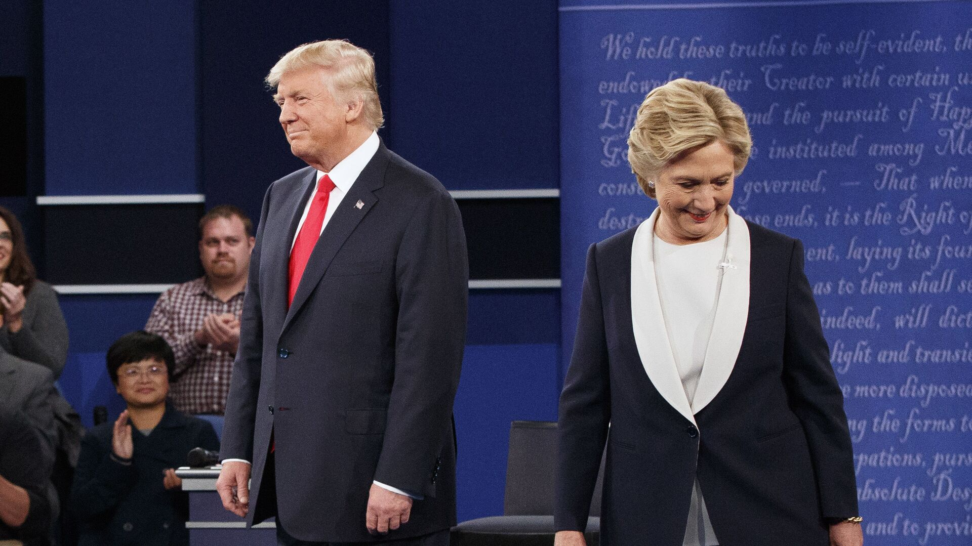 Republican presidential candidate Donald Trump, left, and Democratic presidential candidate Hillary Clinton walk to their seats after arriving for the second presidential debate at Washington University, Sunday, Oct. 9, 2016, in St. Louis - Sputnik International, 1920, 17.09.2021