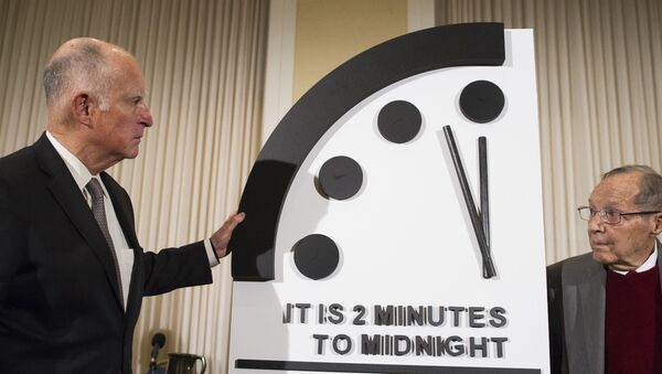 Former California Gov. Jerry Brown, left, and former Secretary of Defense William Perry unveil the Doomsday Clock during The Bulletin of the Atomic Scientists news conference in Washington, Thursday, Jan. 24, 2019. - Sputnik International