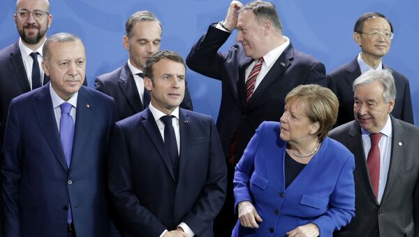 German Chancellor Angela Merkel, front second left, waits for the arrival of leaders prior to a group photo at a conference on Libya at the chancellery in Berlin, Germany, Sunday, Jan. 19, 2020.  - Sputnik International