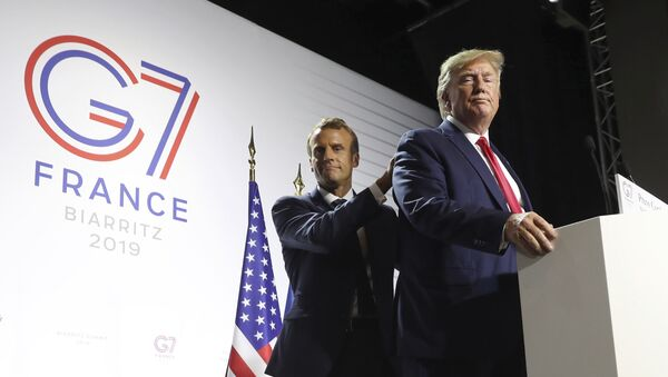 President Donald Trump and French President Emmanuel Macron wrap up a joint press conference at the G-7 summit in Biarritz, France, Monday, Aug. 26, 2019 - Sputnik International