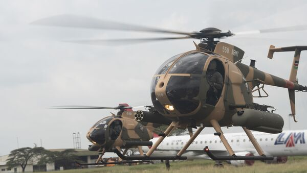 Two MD-530F Cayuse Warrior Helicopters prepare to takeoff during a Helicopter Handover Ceremony at Embakasi Barracks, Kenya, Jan. 23, 2020. The ceremony (During the ceremony, six MD-530F Cayuse Warrior helicopters were delivered to the KDF in a symbolic handover. Six more MD-530F helicopters will be delivered to the KDF in the near future. - Sputnik International