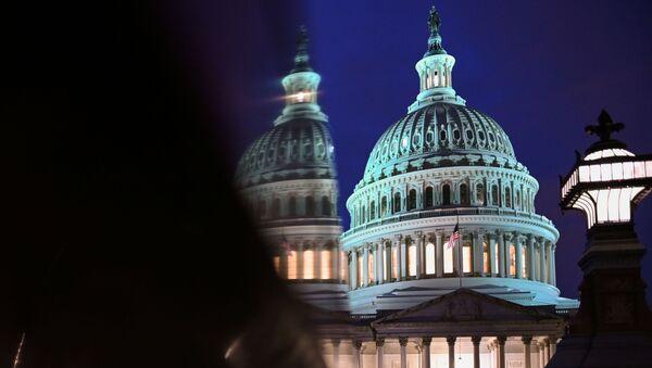 The U.S. Capitol is seen at night - Sputnik International
