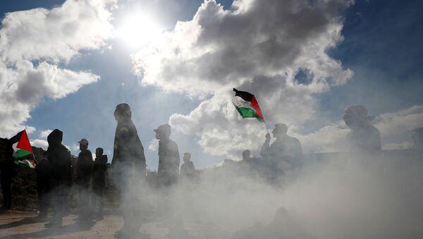 Palestinian demonstrators take part in an anti-Israel protest in al-Mughayyir village near Ramallah, in the Israeli-occupied West Bank, January 3, 2020.  - Sputnik International